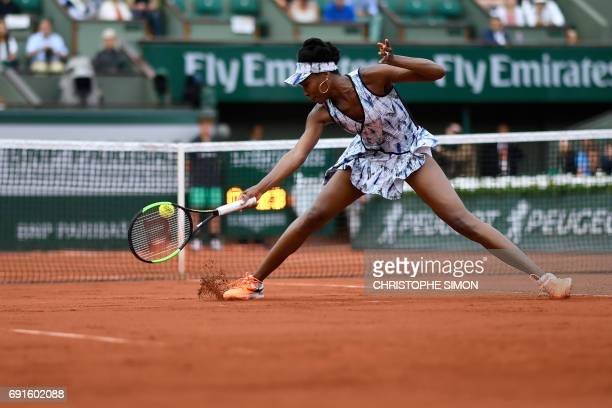 US Venus Williams returns the ball to Belgium's Elise Mertens during their tennis match at the Roland Garros 2017 French Open on June 2 2017 in Paris...