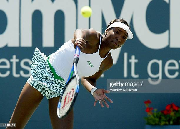 Venus Williams serves to Jelena Kostanic of Croatia during the Family Circle Cup April 17 2004 at the Family Circle Cup Tennis Center in Charleston...