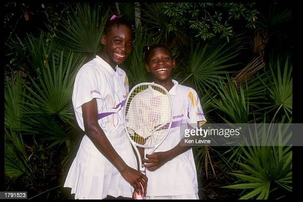 Venus Williams stands with her sister and fellow tennis player Serena Williams