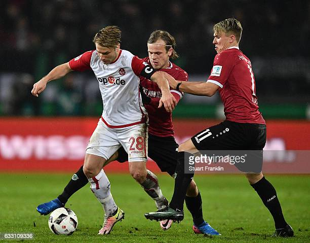 ver Fossum and Felix Klaus of Hannover challenge Daniel Halfar of Kaiserslautern during the Second Bundesliga match between Hannover 96 and 1 FC...