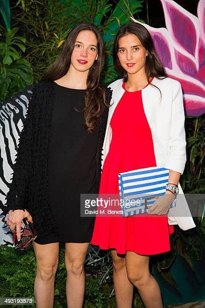 Vera Arrivabene and Viola Arrivabene arrive at Roger Vivier Summer Party at Loulou's on May 22 2014 in London England