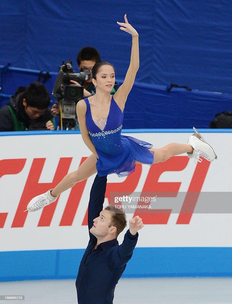 Vera Bazarova (top) and Yuri Larionov (bottom) of Russia perform during the pairs' short program in the NHK Trophy, the last leg of the six-stage ISU figure skating Grand Prix series, in Rifu, northern Japan, on November 24, 2012. AFP PHOTO / Toru YAMANAKA