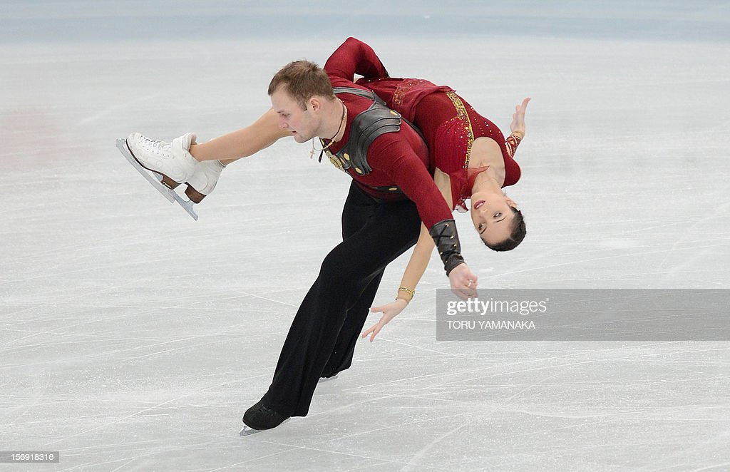 Vera Bazarova (top) and Yuri Larionov (bottom) of Russia perform during the pairs' free skating in the NHK Trophy, the last leg of the six-stage ISU figure skating Grand Prix series, in Rifu, northern Japan, on November 25, 2012. The Russian pair won the gold medals in the competition. AFP PHOTO/Toru YAMANAKA