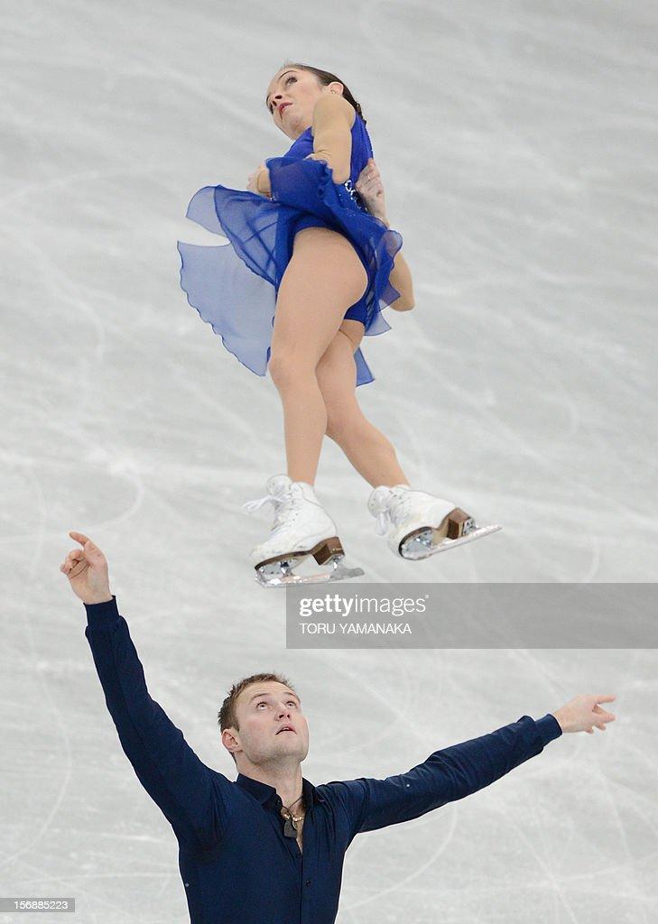 Vera Bazarova (top) and Yuri Larionov (bottom) of Russia perform perform during the pairs' short program in the NHK Trophy, the last leg of the six-stage ISU figure skating Grand Prix series, in Rifu, northern Japan, on November 24, 2012. AFP PHOTO / Toru YAMANAKA