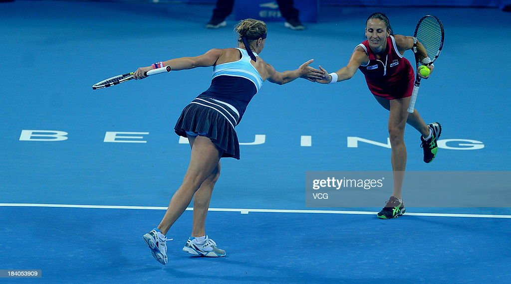 Vera Dushevina and Arantxa Parra Santonja of Spain in action during the women's doubles final match against Cara Black of Zimbabwe and Sania Mirza of...