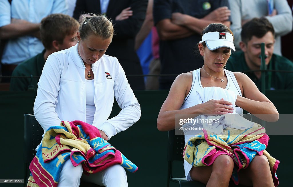 Vera Dushevina of Russia and Chanelle Scheepers of South Africa during their Ladies Doubles first round match against Annika Beck of Germany and...