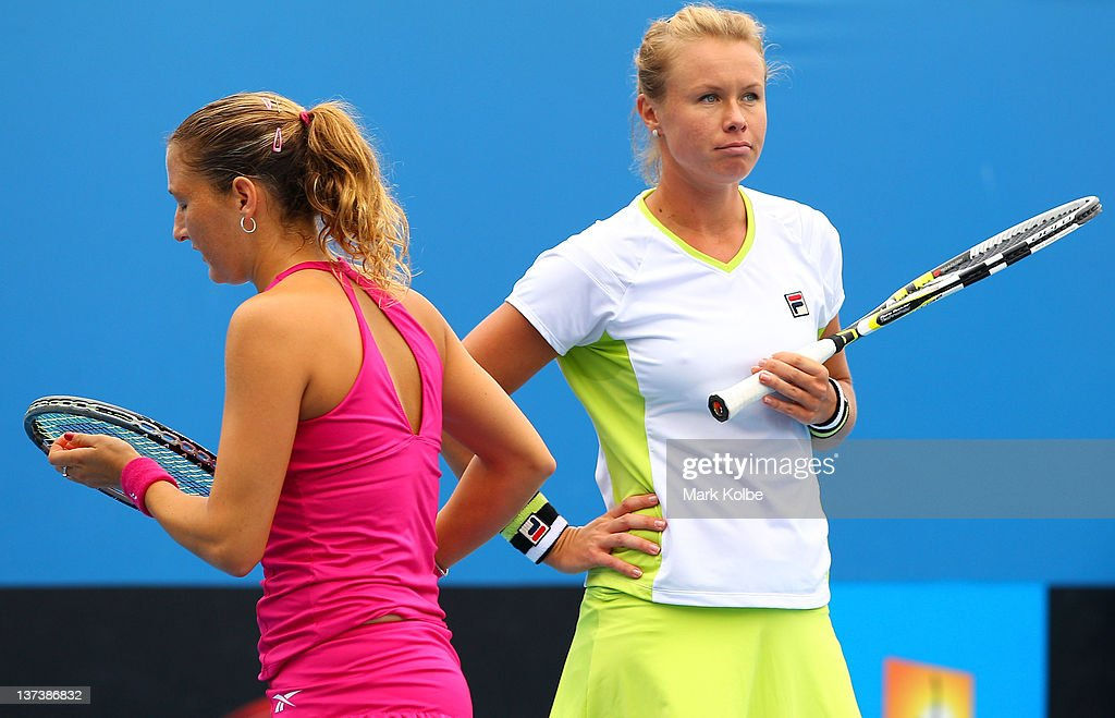 Vera Dushevina of Russia and Shahar Peer of Israel talk tactics in their second round women's doubles match against Jie Zheng of China and Polona...