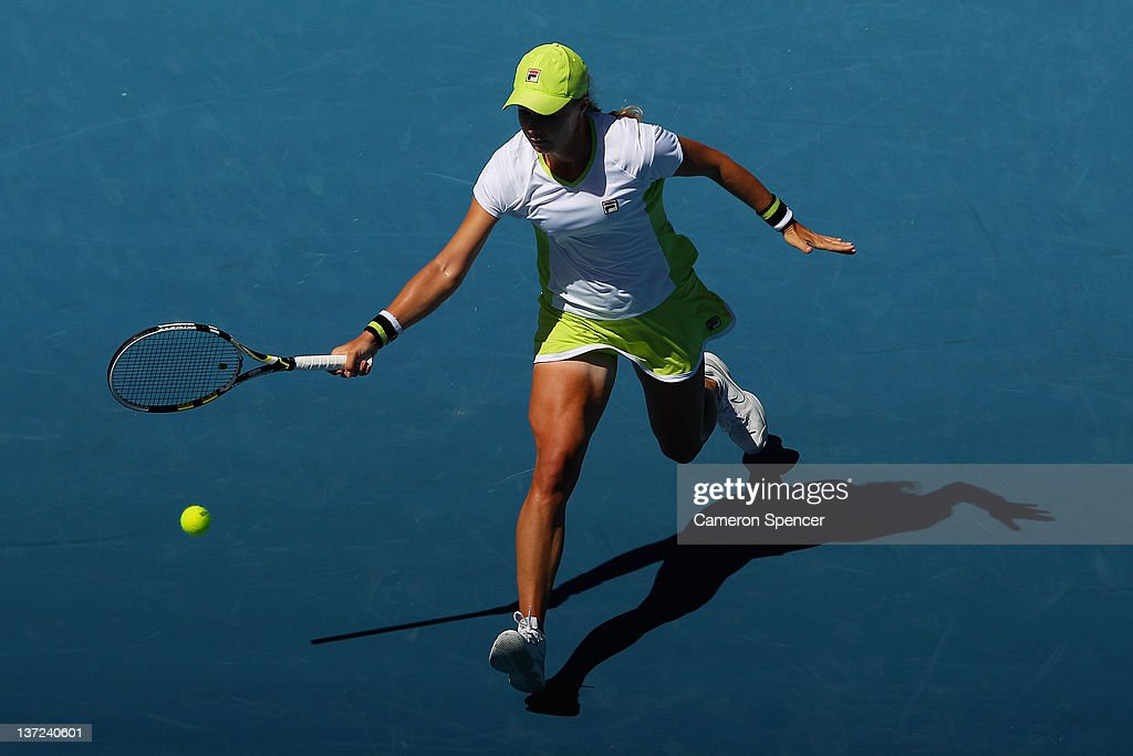 Vera Dushevina of Russia plays a forehand during her first round match against Petra Kvitova of the Czech Republic during day two of the 2012...