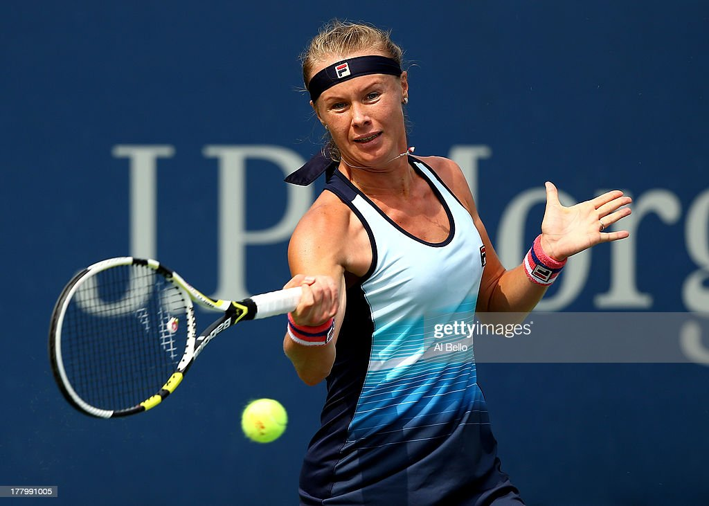 Vera Dushevina of Russia returns a shot against Sabine Lisicki of Germany during their first round women's singles match on Day One of the 2013 US...