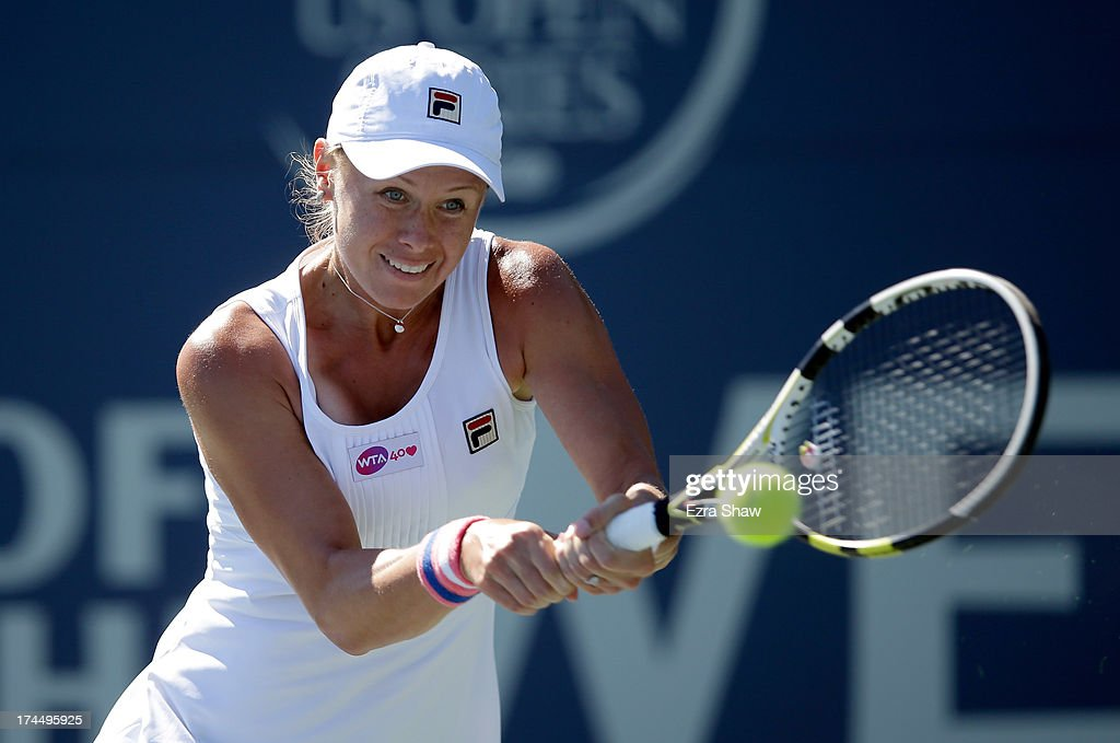 Vera Dushevina of Russia returns a shot to Jamie Hampton during their match on Day 5 of the Bank of the West Classic at Stanford University Taube...