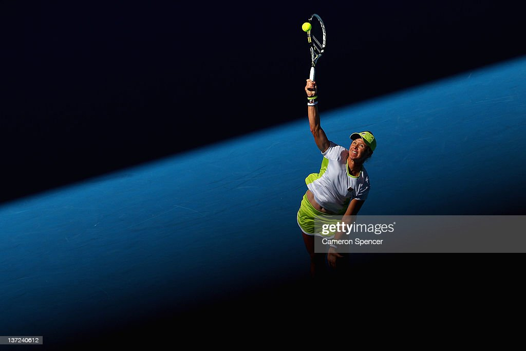 Vera Dushevina of Russia serves during her first round match against Petra Kvitova of the Czech Republic during day two of the 2012 Australian Open...