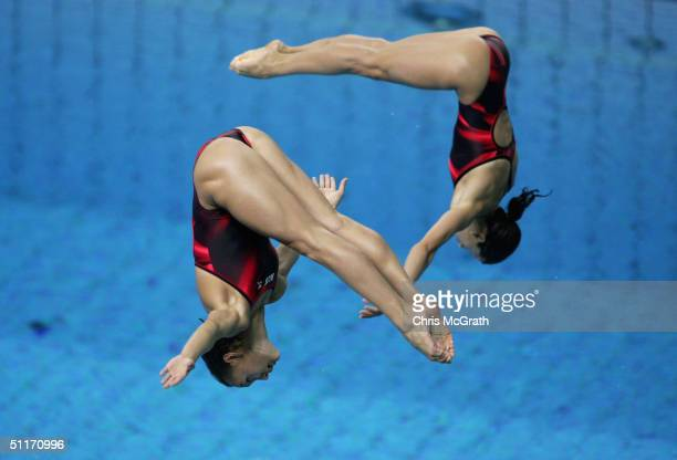 Vera Ilyina and Yulia Pakhalina of Russia compete in the women's synchronised diving 3 metre springboard event on August 14 2004 during the Athens...