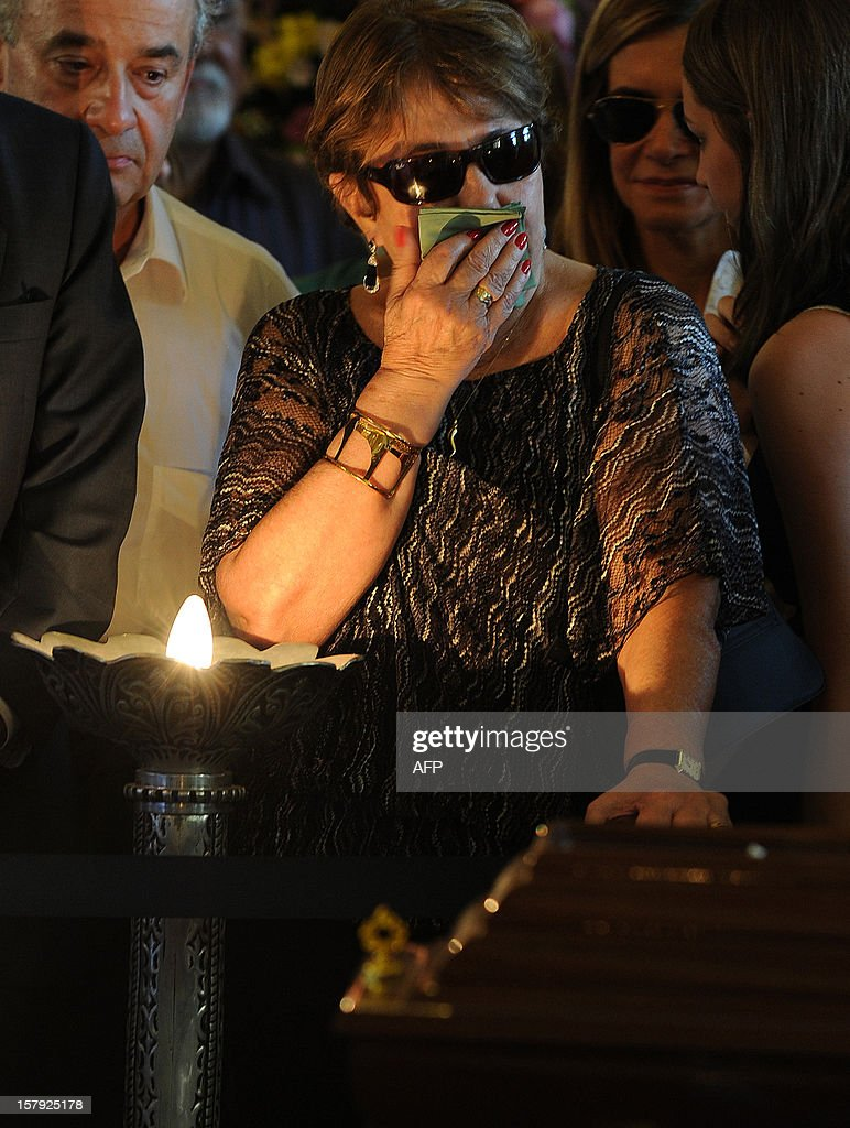 Vera Lucia, cries during the funeral of her husband, Brazilian architect Oscar Niemeyer, at the City Palace in Rio de Janeiro, Brazil on December 7, 2012. Niemeyer, the Brazilian icon who revolutionized modern architecture and designed much of the country's futuristic capital Brasilia, died in Rio de Janeiro Wednesday at 104. AFP PHOTO /VANDERLEI ALMEIDA