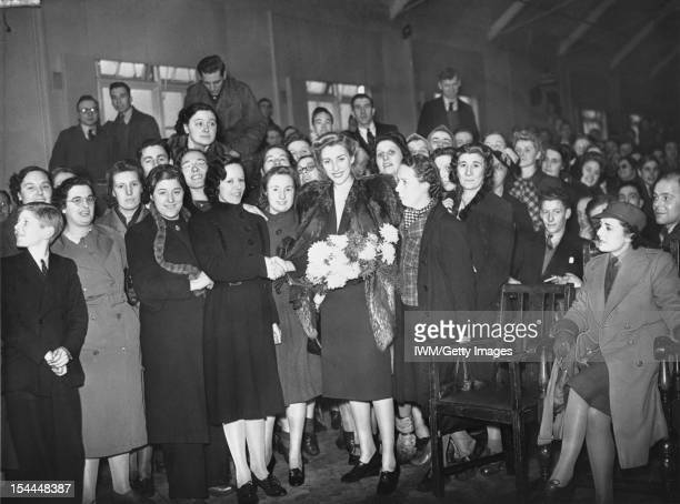 Vera Lynn Visits A Munitions Factory UK Vera Lynn stands with a large group of munitions workers following a lunchtime concert at a factory somewhere...