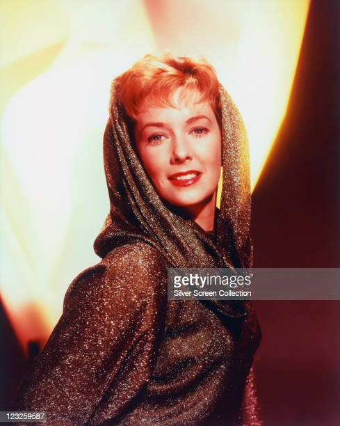Vera Miles US actress wearing a lurex top and headscarf in a studio portrait circa 1965