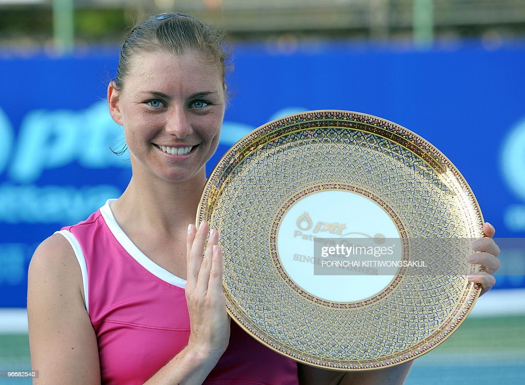Vera Zvonareva of Russia celebrates with the trophy after winning against Thailand's Tamarine Tanasugarn during the final round of WTA Pattaya Open...
