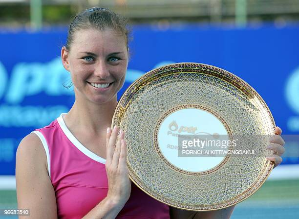 Vera Zvonareva of Russia celebrates with the trophy after winning against Thailand's Tamarine Tanasugarn during the final round of WTA Pattaya Open...