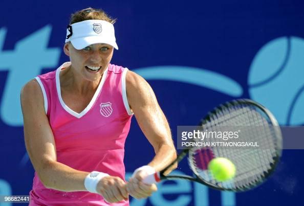Vera Zvonareva of Russia hits a return against Thailand's Tamarine Tanasugarn during the final round of WTA Pattaya Open tennis tournament at the...