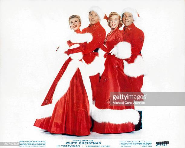 VeraEllen Danny Kaye Rosemary Clooney and Bing Crosby dressed in Christmas stage costumes in a scene from the film 'White Christmas' 1954