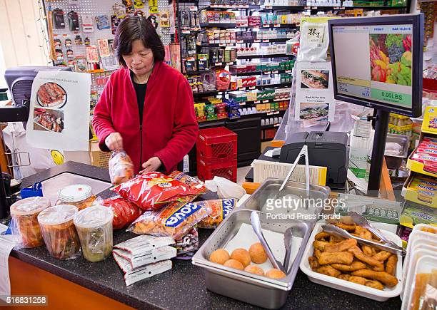 Veranda Asian Market cashier Mei Lam rings up a customers purchase at the Forest Avenue Portland market Veranda Asian Market's owners were the...
