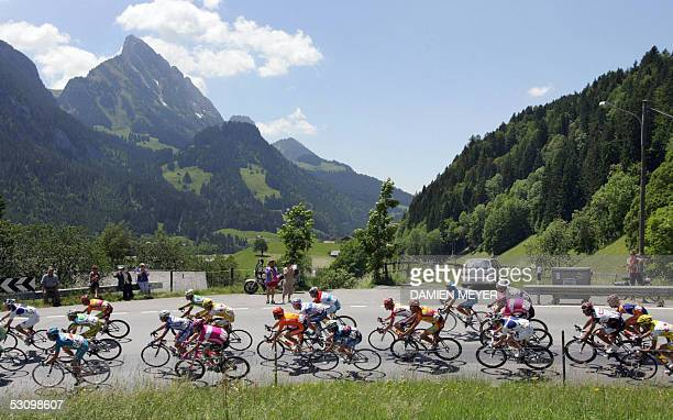 The pack rides during the 8th stage of the 69th 'Tour de Suisse' cycling race between Lenk and Verbier 18 June 2005 Spain's Pablo Lastras won the...
