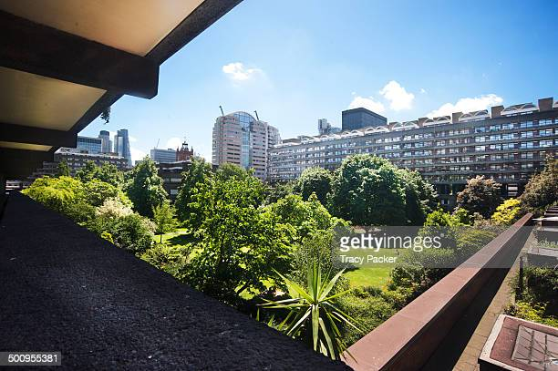 A verdant green garden is overlooked by the balconies of the Grade II Listed Brutalist tower blocks at the Barbican Estate in the heart of the City...