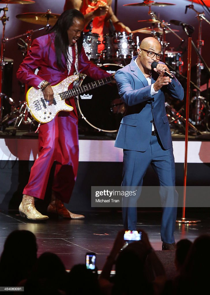 <a gi-track='captionPersonalityLinkClicked' href=/galleries/search?phrase=Verdine+White&family=editorial&specificpeople=211265 ng-click='$event.stopPropagation()'>Verdine White</a> (L) and <a gi-track='captionPersonalityLinkClicked' href=/galleries/search?phrase=T.I.&family=editorial&specificpeople=221599 ng-click='$event.stopPropagation()'>T.I.</a> perform at the GRAMMY Nominations Concert Live! held at Nokia Theatre L.A. Live on December 6, 2013 in Los Angeles, California.