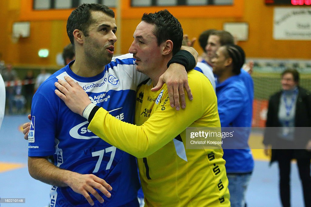 Verdran Zrnic and Borko Ristovski of Gummersbach celebrate after the DKB Handball Bundesliga match between VfL Gummersbach and FrischAuf Goeppingen at Eugen-Haas-Sporthalle on February 20, 2013 in Gummersbach, Germany.