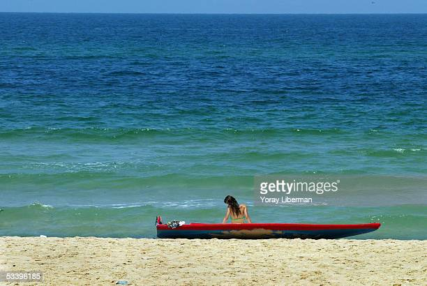 Vered Hazani sits on her husband's boat as she takes a break from packing their their beachfront home August 16 2005 in Kfar Yam Gaza Strip As...