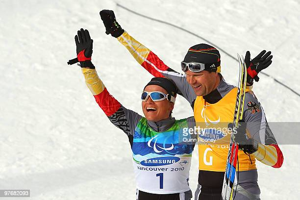 Verena Bentele and her guide Thomas Friedrich of Germany celebrate winning the Women's 3km Pursuit Visually Impaired Biathlon on Day 2 of the 2010...