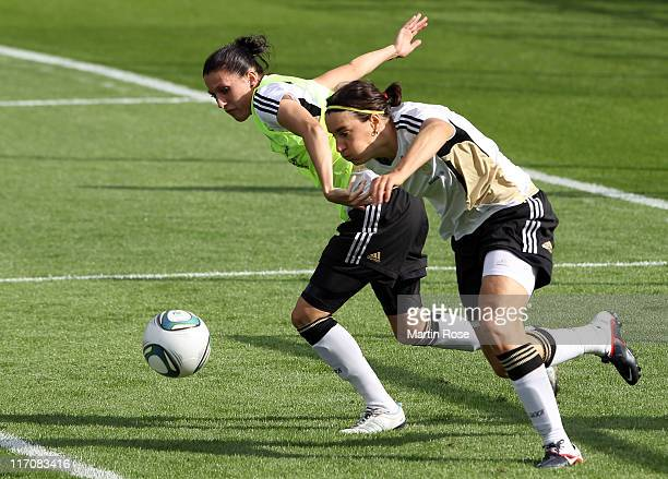 Verena Faisst and Birgit Print of Germany battle for the ball during the Germany Women national team training session at Wurfplatz stadium on June 21...