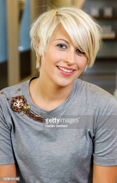 Verena Kerth poses for a picture after she gots her new haircut by stylist Ayse Auth at Haarwerk on July 2 2010 in Munich Germany
