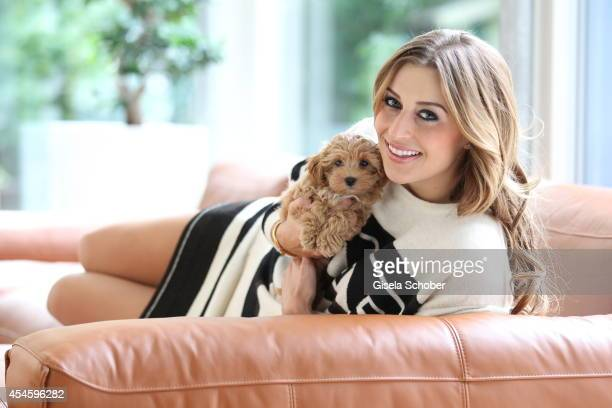 Verena Kerth poses with her new dog Mucki Macchiato during a photo session on September 2 2014 in Munich Germany
