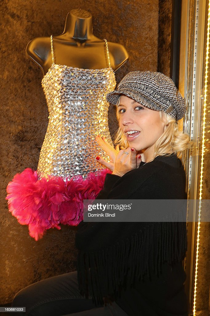 Verena Kerth poses with the Costume Katy Perry wore at Hollywood Palladium during the Hello Katy tour 2009 at the opening of the exhibition Hard Rock Couture - Music Inspired Fashion at the Hard Rock Cafe on March 14, 2013 in Munich, Germany.