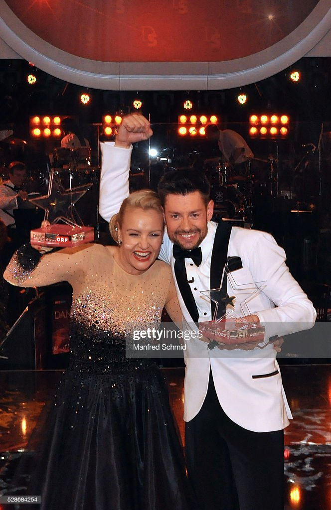 Verena Scheitz (L) and Florian Gschaider win and pose during the 'Dancing Stars' finals in Vienna at ORF Zentrum on May 6, 2016 in Vienna, Austria.