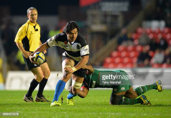 Vereniki Goneva of Leicester Tigers tackles Steven Luatua of Barbarians during the match between Leicester Tigers and Barbarians at Welford Road on...