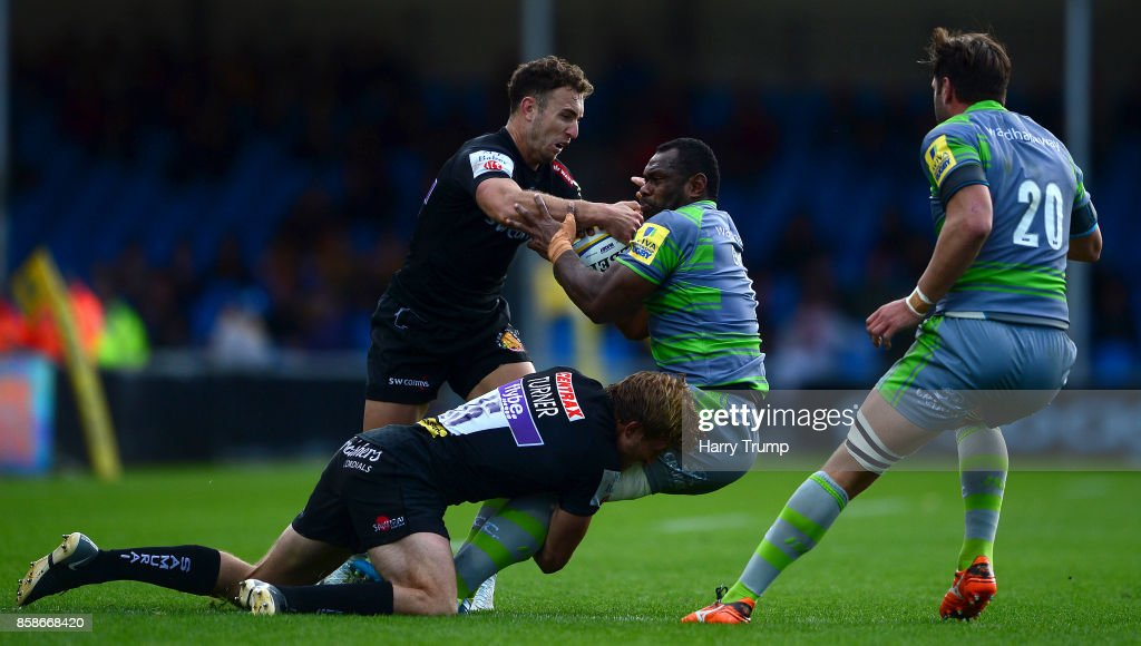 Vereniki Goneva of Newcastle Falcons is tackled by Lachie Turner of Exeter Chiefs and Nic White of Exeter Chiefs during the Aviva Premiership match between Exeter Chiefs and Newcastle Falcons at Sandy Park on October 7, 2017 in Exeter, England.