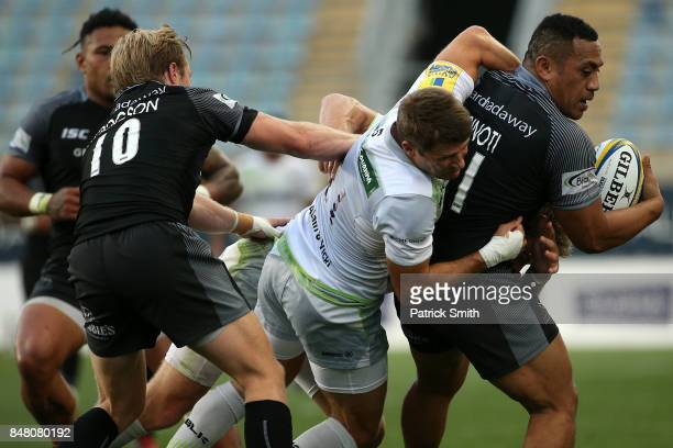 Vereniki Goneva of the Newcastle Falcons is tackled by Richard Wigglesworth of the Saracens during a Aviva Premiership match between the Newcastle...