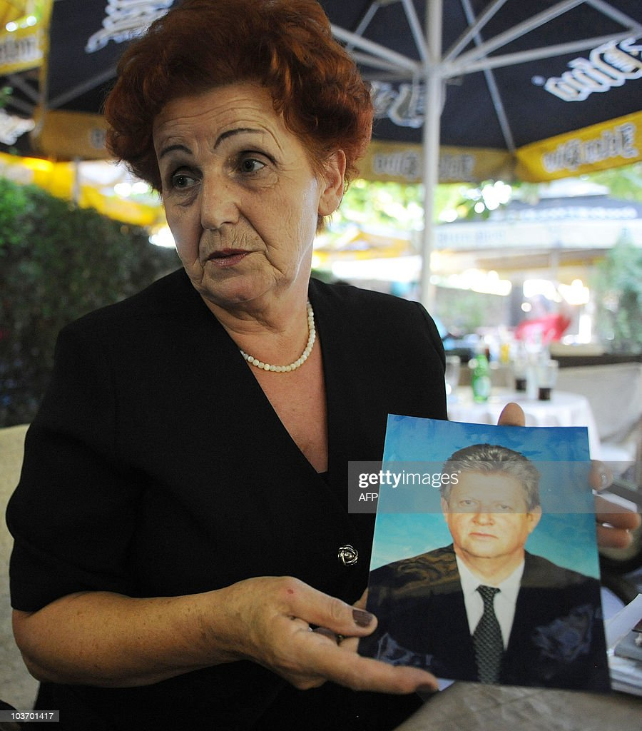 SUBASIC -- Verica Tomanovic holds on August 23, 2010 in Belgrade, a picture of her husband who disappeared in Kosovo in 1999, one of some 14,650 people unaccounted for after the wars in Croatia, Bosnia Hercegovina and Kosovo which tore apart the former Yugoslavia in the 1990s. A book and photo exhibition called 'Missing Lives' presents 15 stories selected among thousands and is also designed to serve as a tool to solving more cases at a faster pace. Families throughout the western Balkans still hope to find out what has happened to their missing loved ones, if only to bury and grieve for them properly. AFP PHOTO / Alexa STANKOVIC