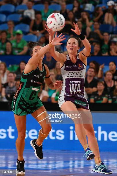 Verity Charles of the Fever and Caitlyn Nevins of the Firebirds contest for the ball during the round three Super Netball match between the Fever and...
