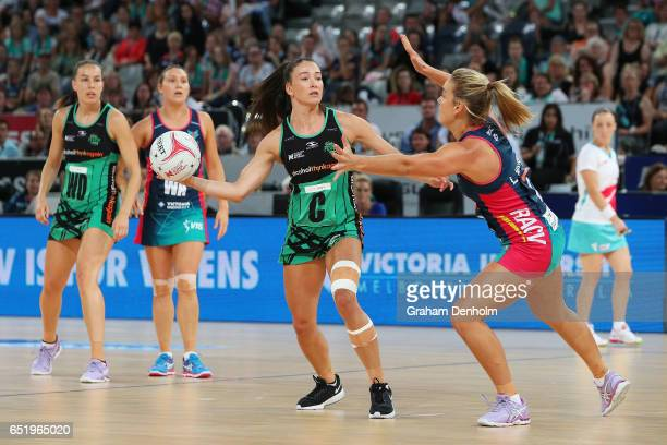 Verity Charles of the Fever looks to pass during the round four Super Netball match between the Vixens and the Fever at Hisense Arena on March 11...