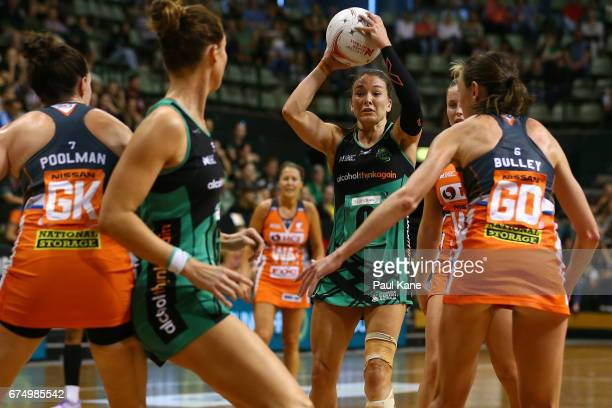 Verity Charles of the Fever looks to pass the ball during the round 10 Super Netball match between the Fever and the Giants at HBF Stadium on April...