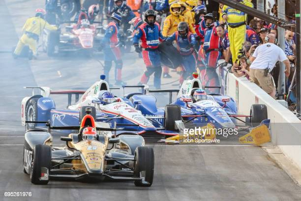 Verizon IndyCar Series driver James Hinchcliffe leaves pit road after forcing Verizon IndyCar Series driver Helio Castroneves to crash into Verizon...