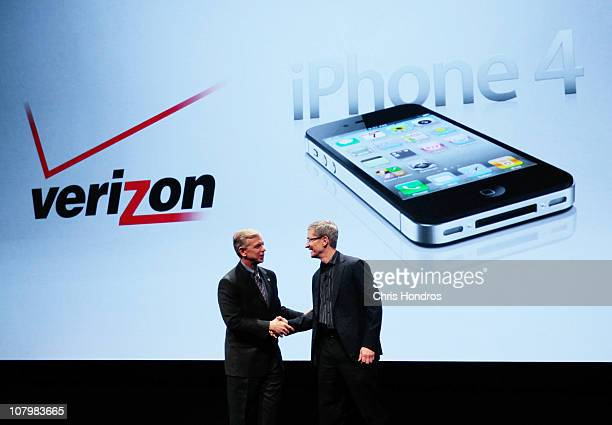 Verizon President and COO Lowell McAdam shakes hands with Apple Chief Operating Officer Tim Cook during the iPhone announcement January 11 2011 in...