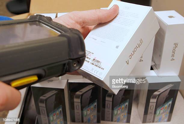 Verizon Wireless inventory specialist Bobby Gibson unloads and scans Apple Inc iPhone 4's in Draper Utah US on Wednesday Feb 9 2011 Verizon Wireless...