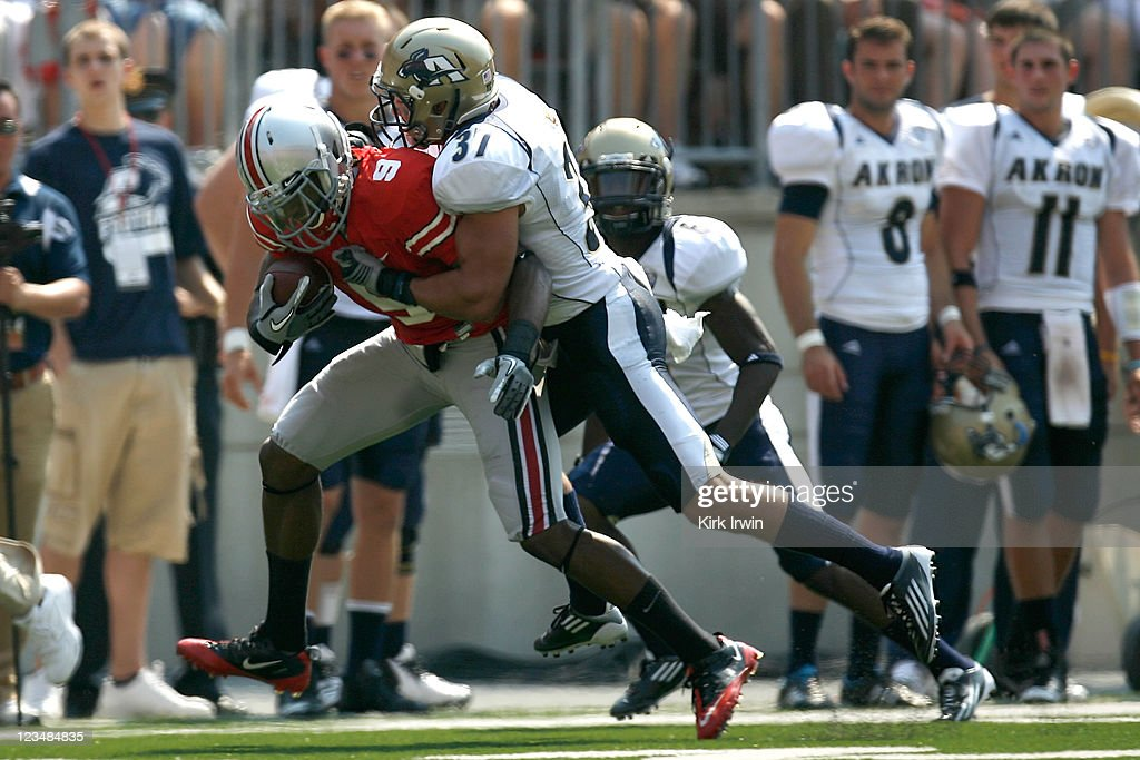 Verlon Reed #9 of the Ohio State Buckeyes is tackled by Seth Cunningham #37 of the Akron Zips during the first quarter on September 3, 2011 at Ohio Stadium in Columbus, Ohio. Ohio State defeated Akron 42-0.