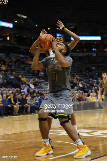 Vermont Catamounts forward Anthony Lamb drives the lane during a game between the Marquette Golden Eagles and the Vermont Catamounts at the BMO...