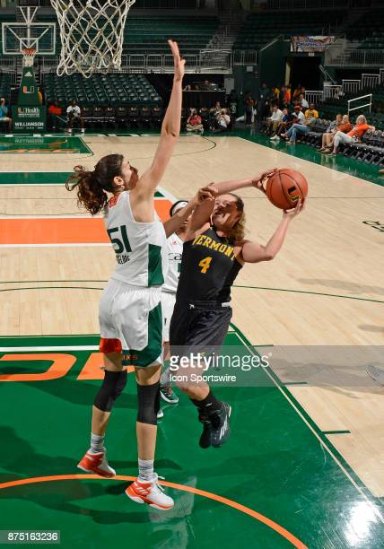 Vermont guard Hayley Robertson shoots against Miami center SerenaLynn Geldof during a women's college basketball game between the University of...