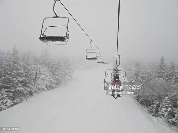 USA, Vermont, Killington, Skier on chair lift