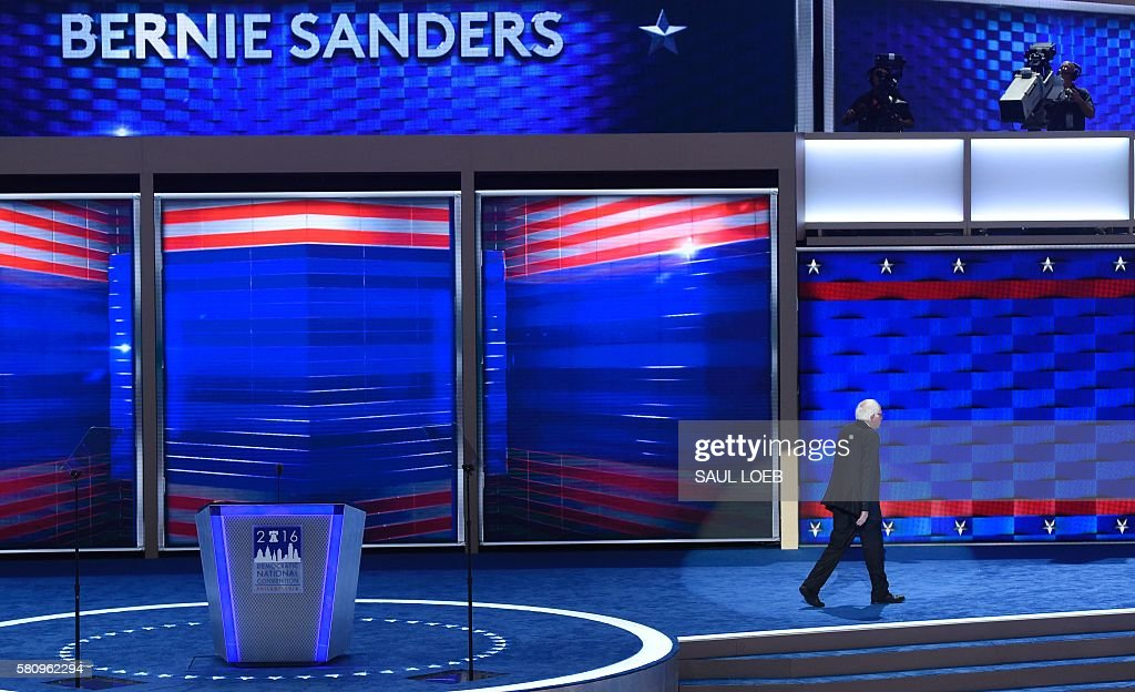 Vermont Senator and former Democratic presidential candidate Bernie Sanders leaves the stage after speaking on Day 1 of the Democratic National Convention at the Wells Fargo Center in Philadelphia, Pennsylvania, July 25, 2016. / AFP / SAUL